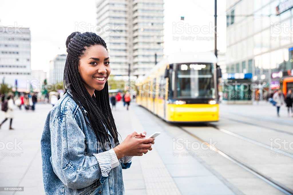 Young woman walking in Berlin - Alexanderplatz stock photo
