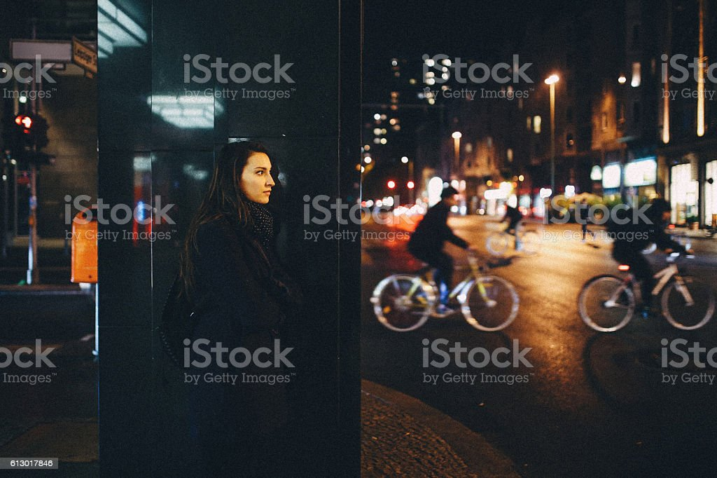 Young woman walking in Berlin at night stock photo