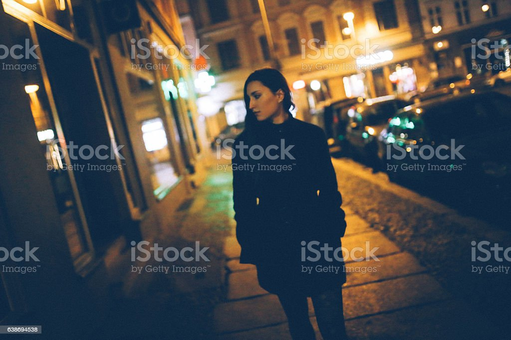 Young woman walking in Berlin Mitte stock photo
