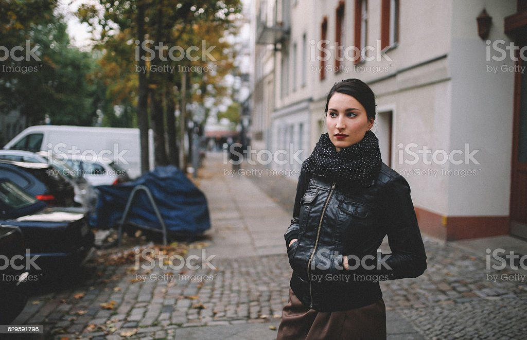 Young woman walking in Berlin Prenzlauer Berg - Mitte stock photo