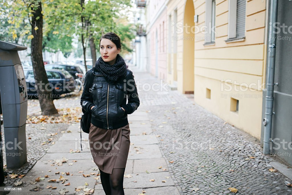 Young woman walking in Berlin Prenzlauer Berg stock photo