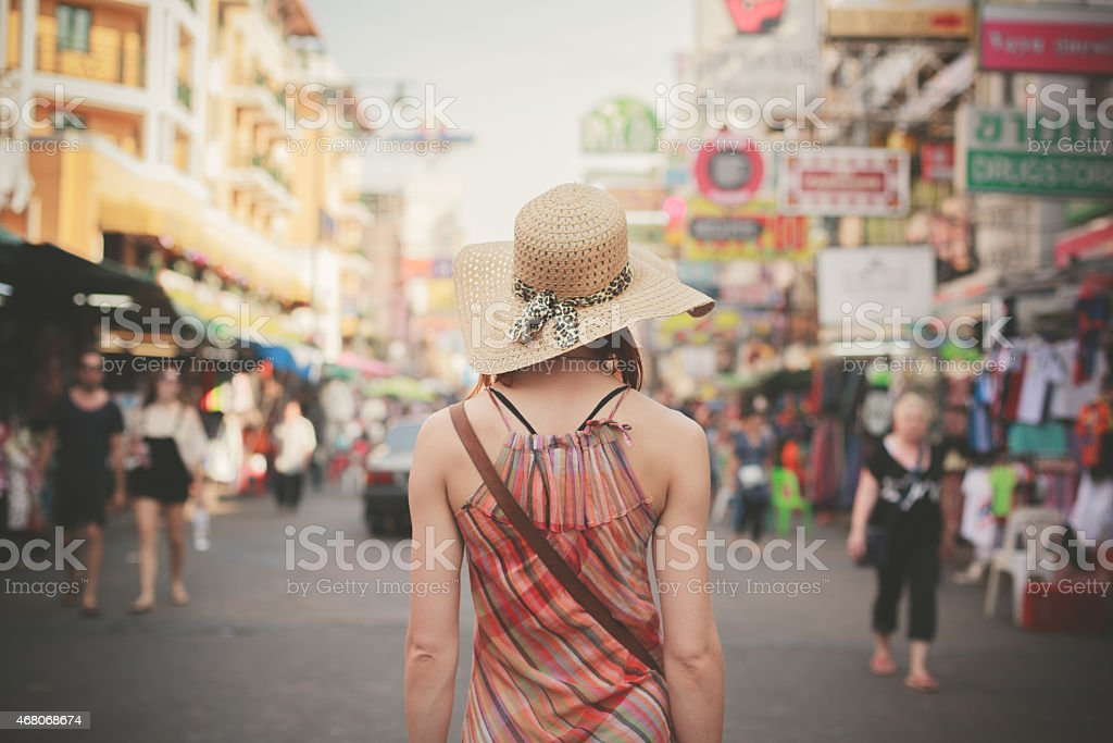 Young woman walking in Khao San, Bangkok stock photo