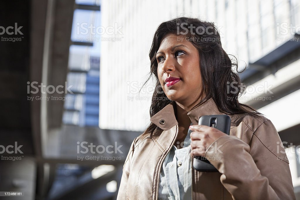 Young woman walking in the city stock photo