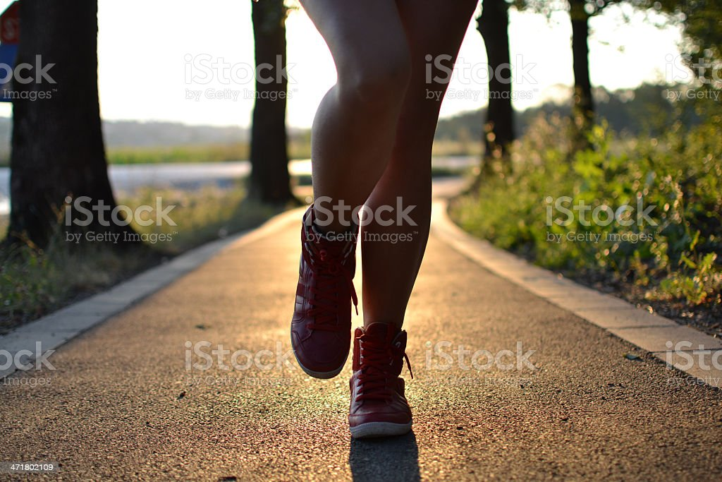 young woman walking in the park royalty-free stock photo