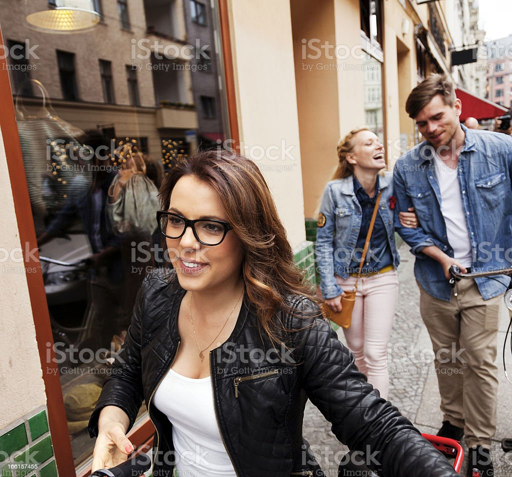 Young Woman Walking in the Street with Friends royalty-free stock photo