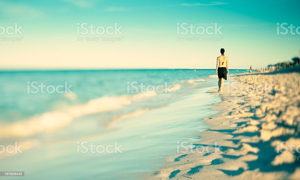 Young woman walking in the sunset royalty-free stock photo