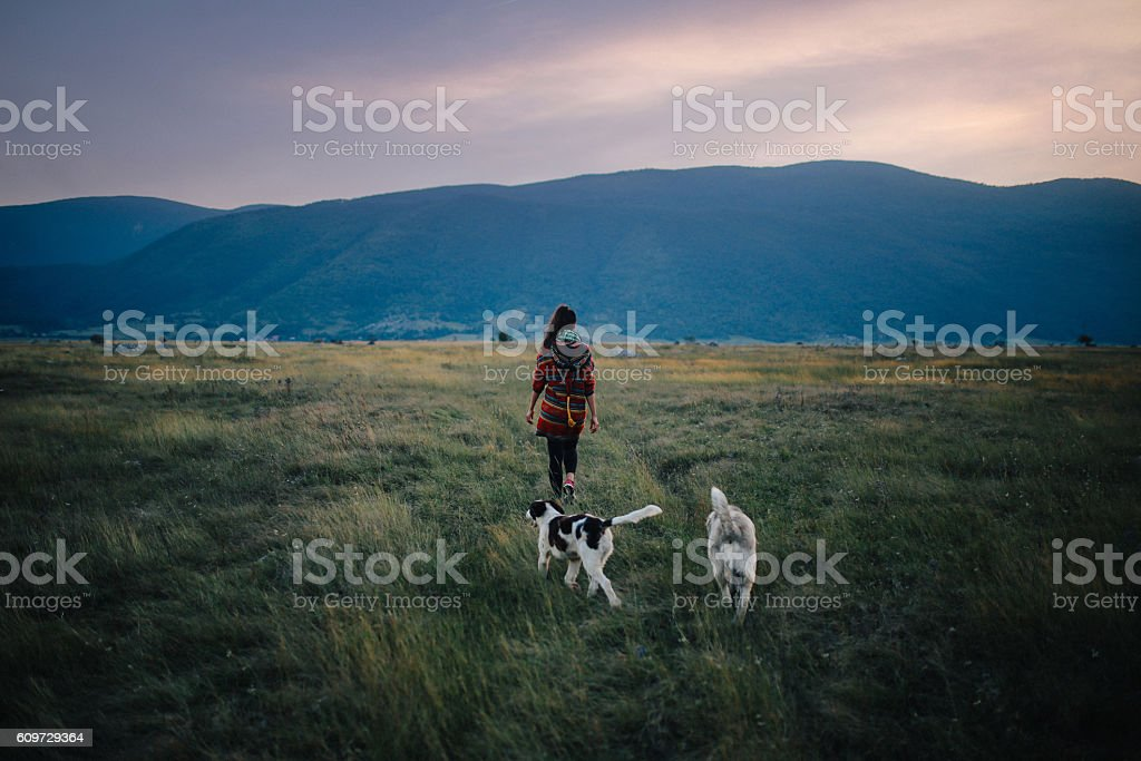 Young woman walking in the wilderness stock photo