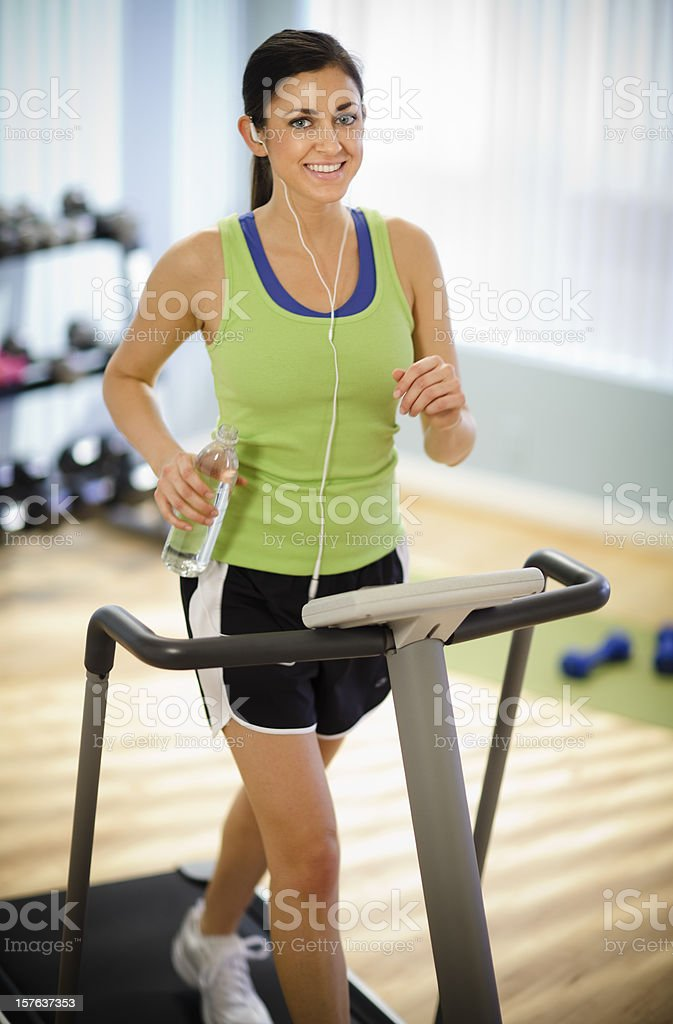 Young Woman Walking on a Treadmill royalty-free stock photo