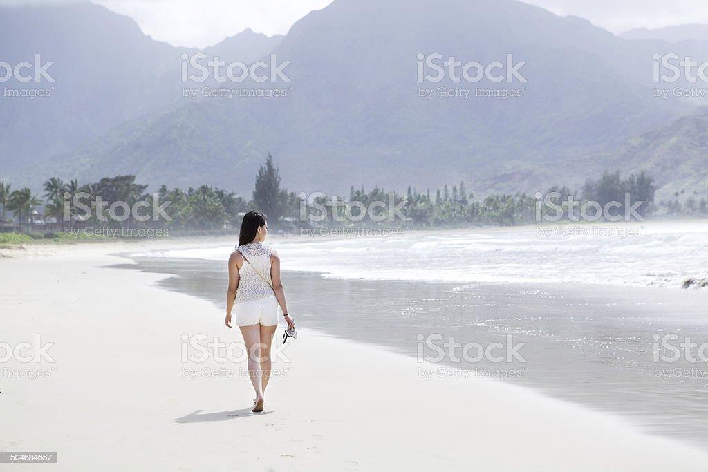 Young Woman Walking on Beach of Hanalei Bay, Kauai Hawaii royalty-free stock photo