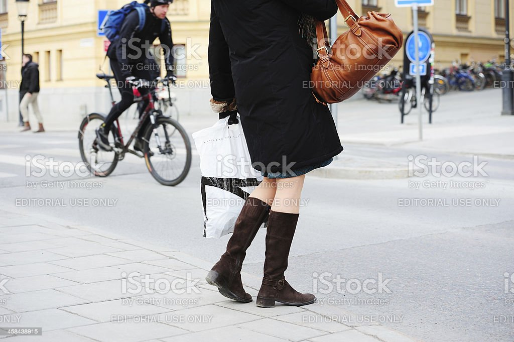 Young woman walking on sidewalk royalty-free stock photo