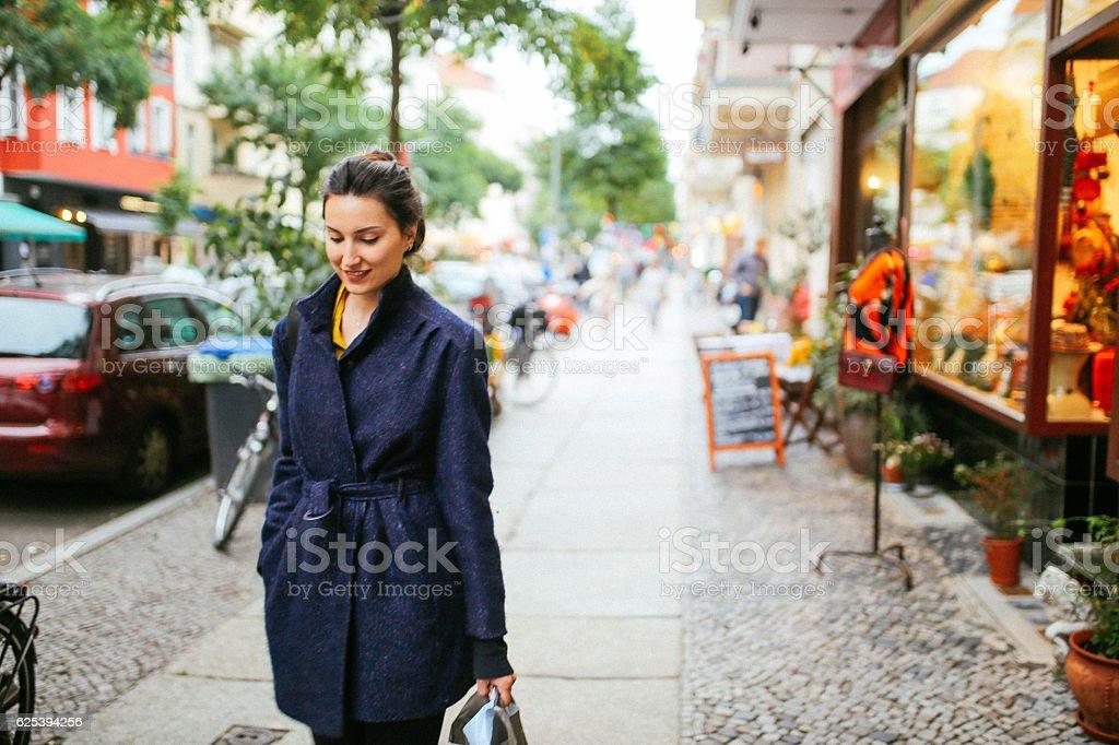 Young woman walking on streets of Berlin, Prenzlauer Berg stock photo