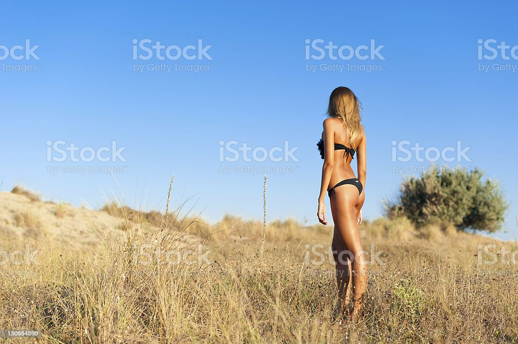 Young woman walking on the seaside royalty-free stock photo