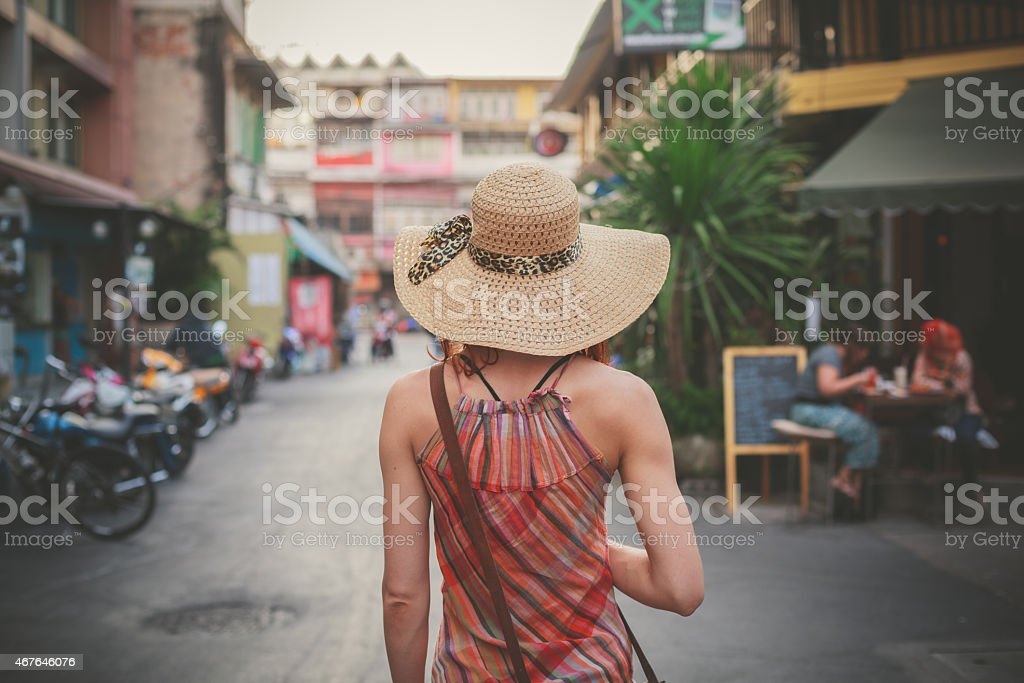 Young woman walking on the street in asian country stock photo