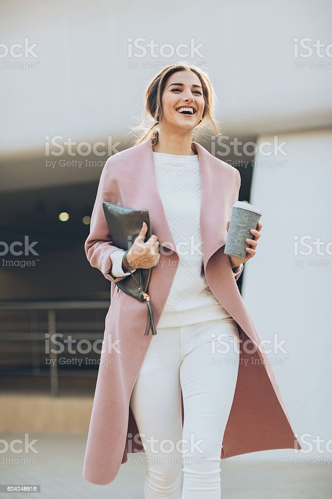 Young woman walking outdoors stock photo