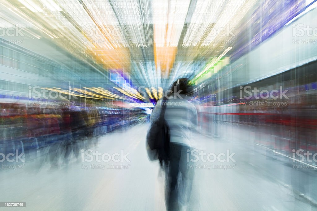 Young Woman Walking Through Airport Terminal, Blurred motion royalty-free stock photo