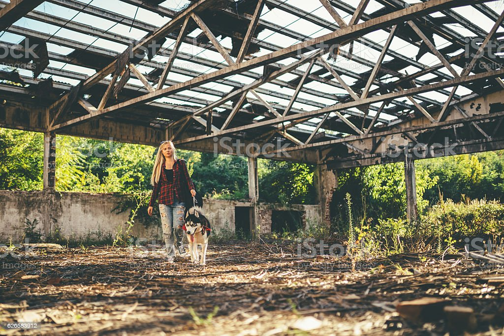 Young woman walking with dog stock photo