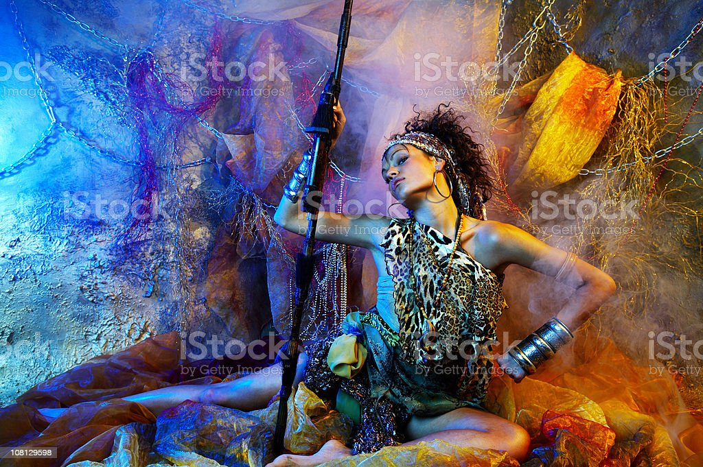 Young Woman Warrior Holding Spear and Posing stock photo
