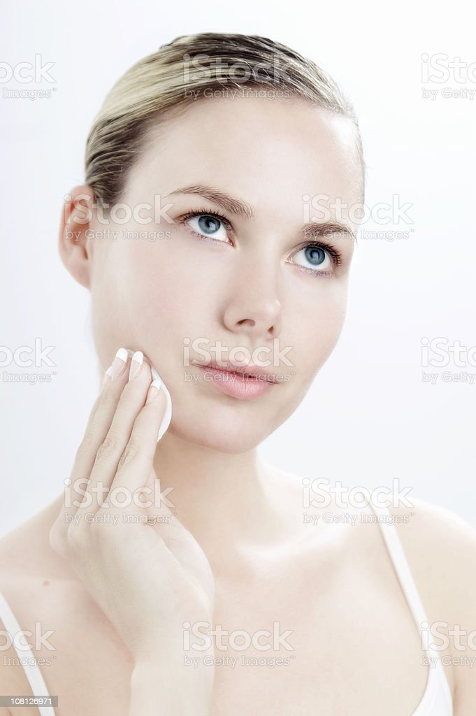 Young Woman Washing Face royalty-free stock photo