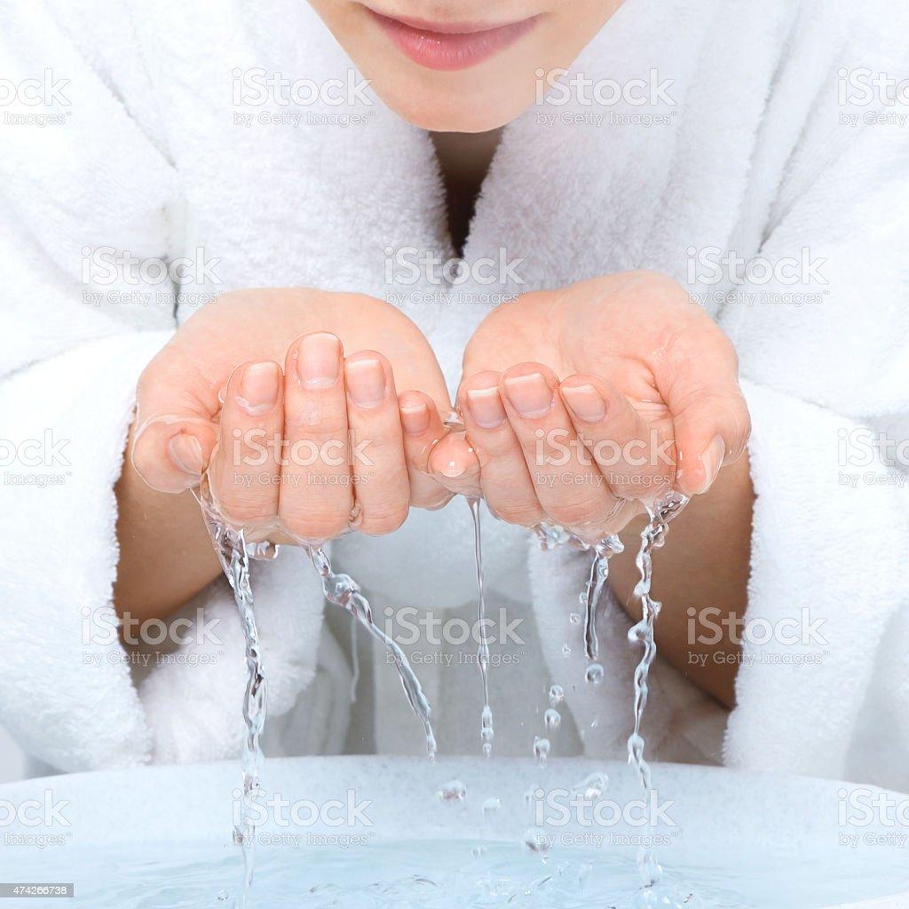Young woman washing face stock photo