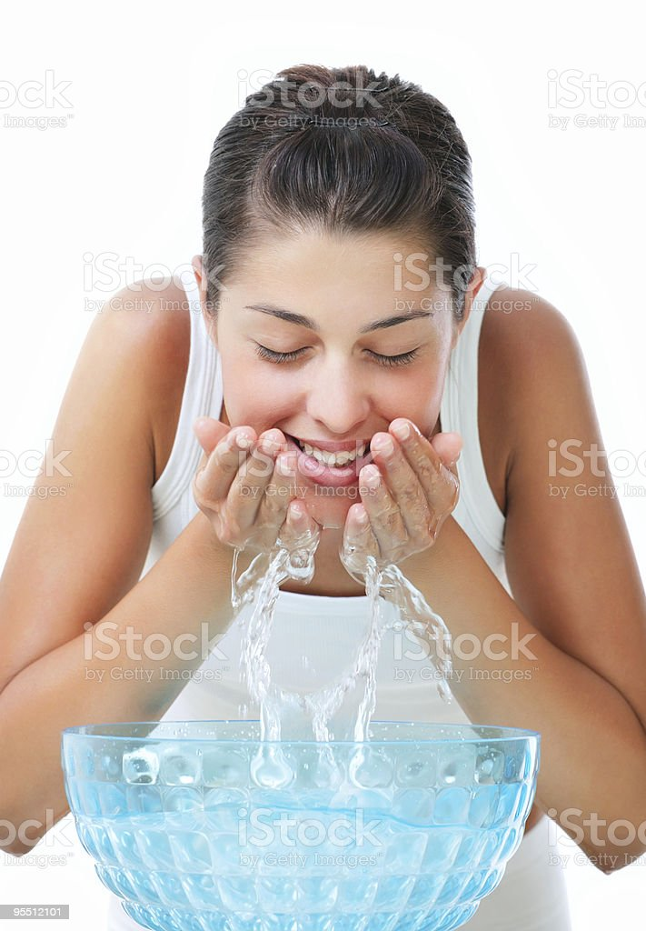 Young woman washing her face royalty-free stock photo