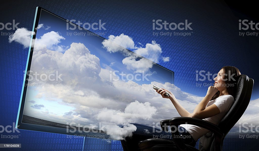 Young woman watching 3d tv royalty-free stock photo