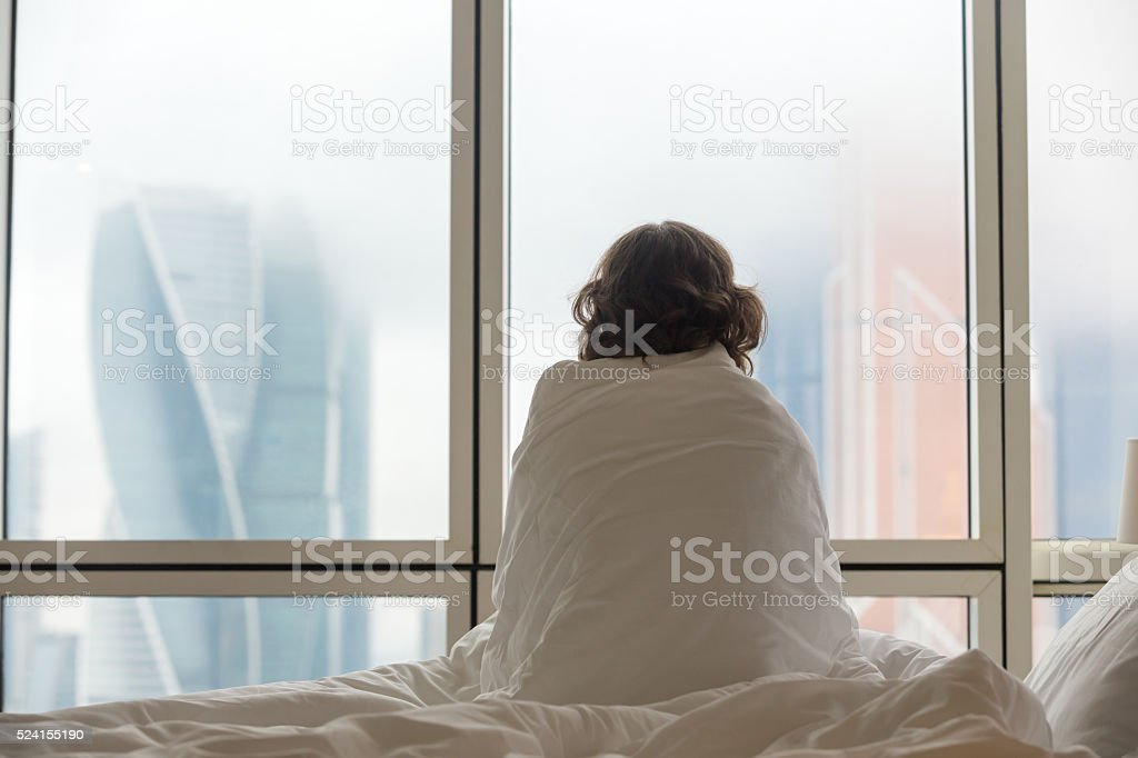 Young woman watching city view in the morning stock photo