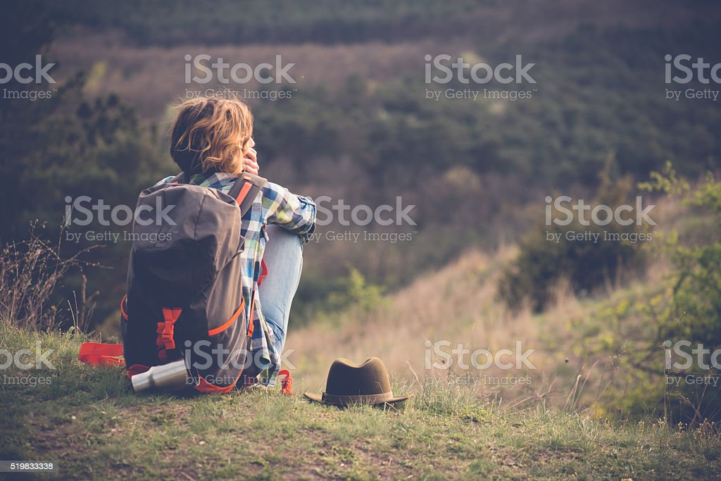 Young woman watching landscape, posing outdoor. Active lifestyle concept. stock photo