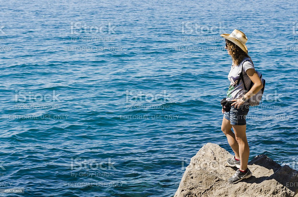 young woman watching sea and looking for royalty-free stock photo