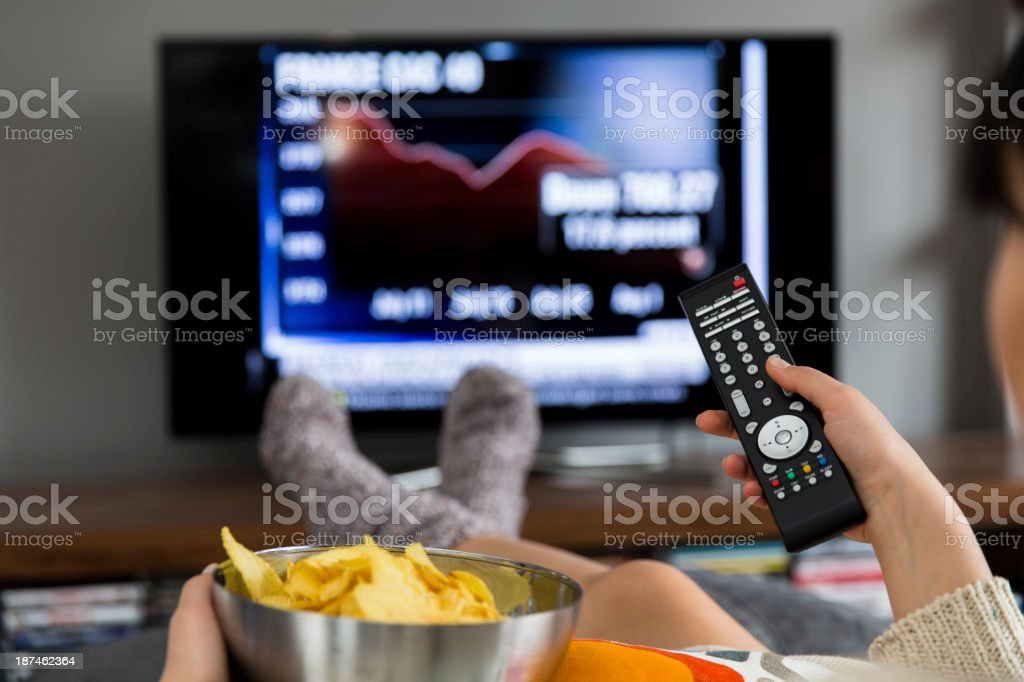 Young woman watching stock market news stock photo