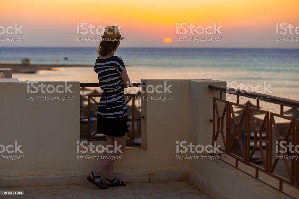 Young woman watching sunrise stock photo