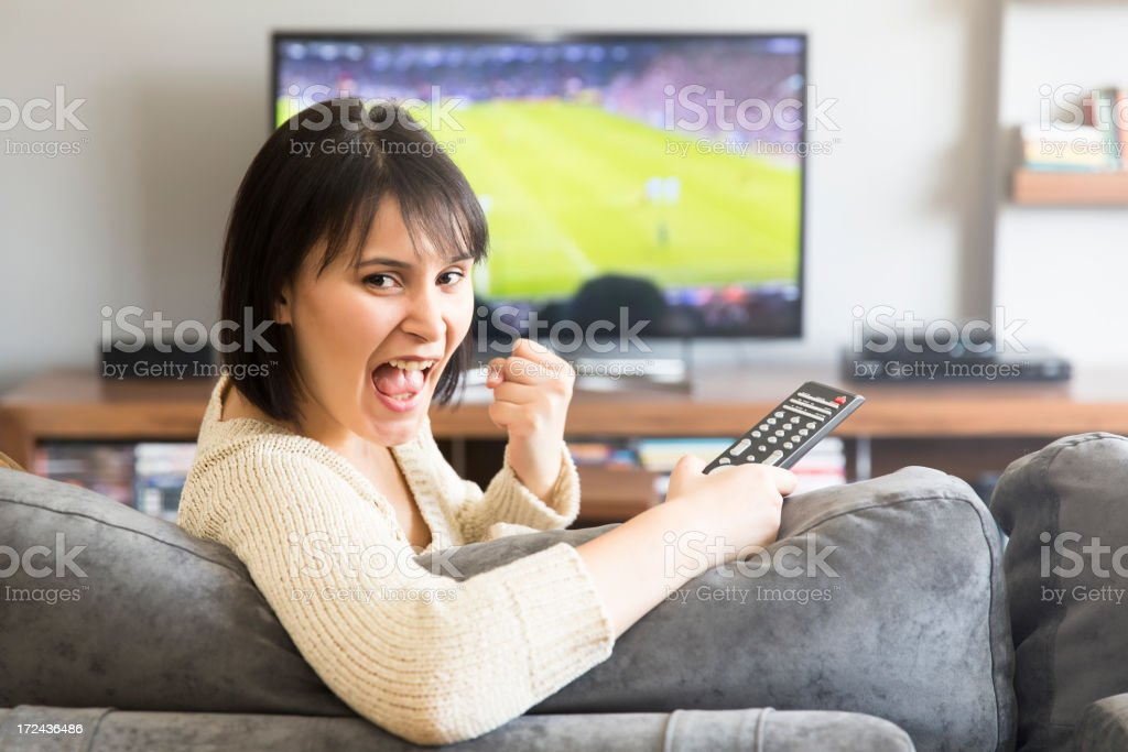young woman watching television stock photo