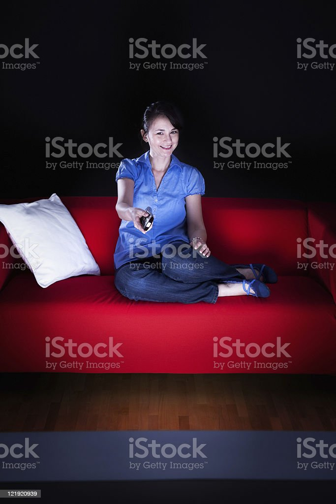 Young woman watching tv in the evening. royalty-free stock photo