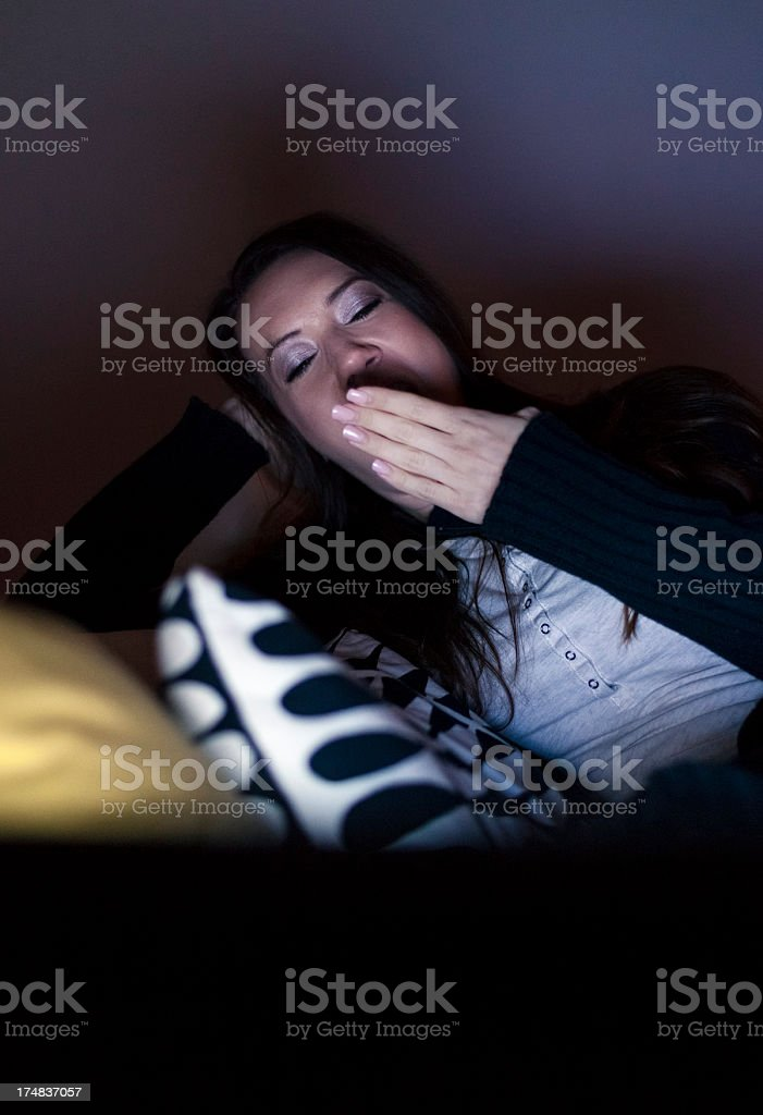 Young woman watching TV late at night royalty-free stock photo