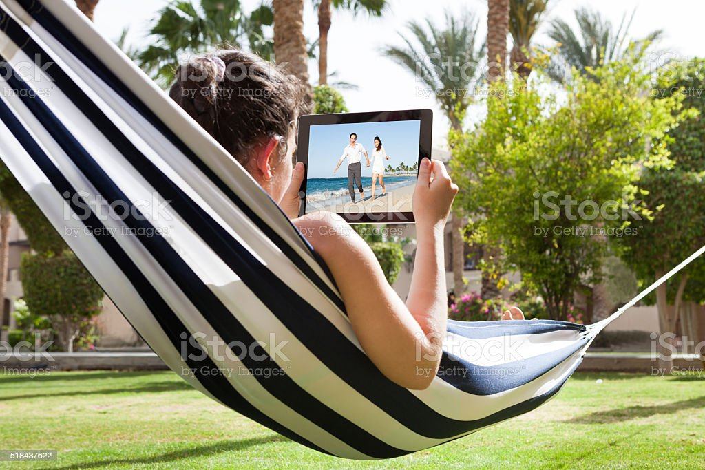 Young Woman Watching Video On Digital Tablet stock photo