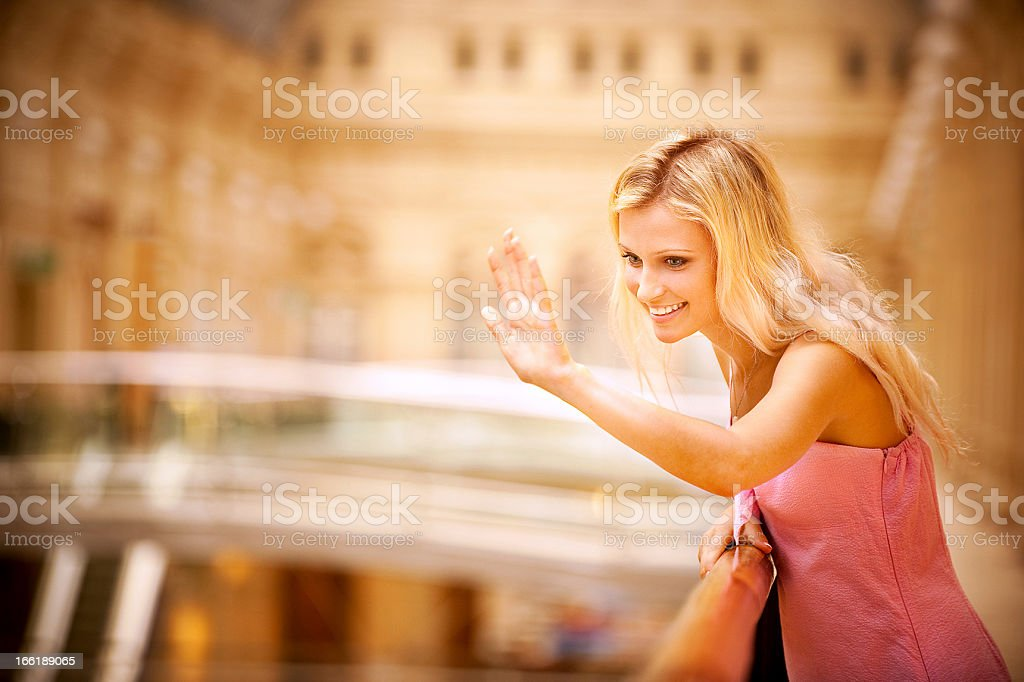 Young woman waves hand royalty-free stock photo