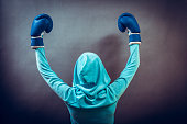 Young woman wear hoodie victory pose show emotion with arms