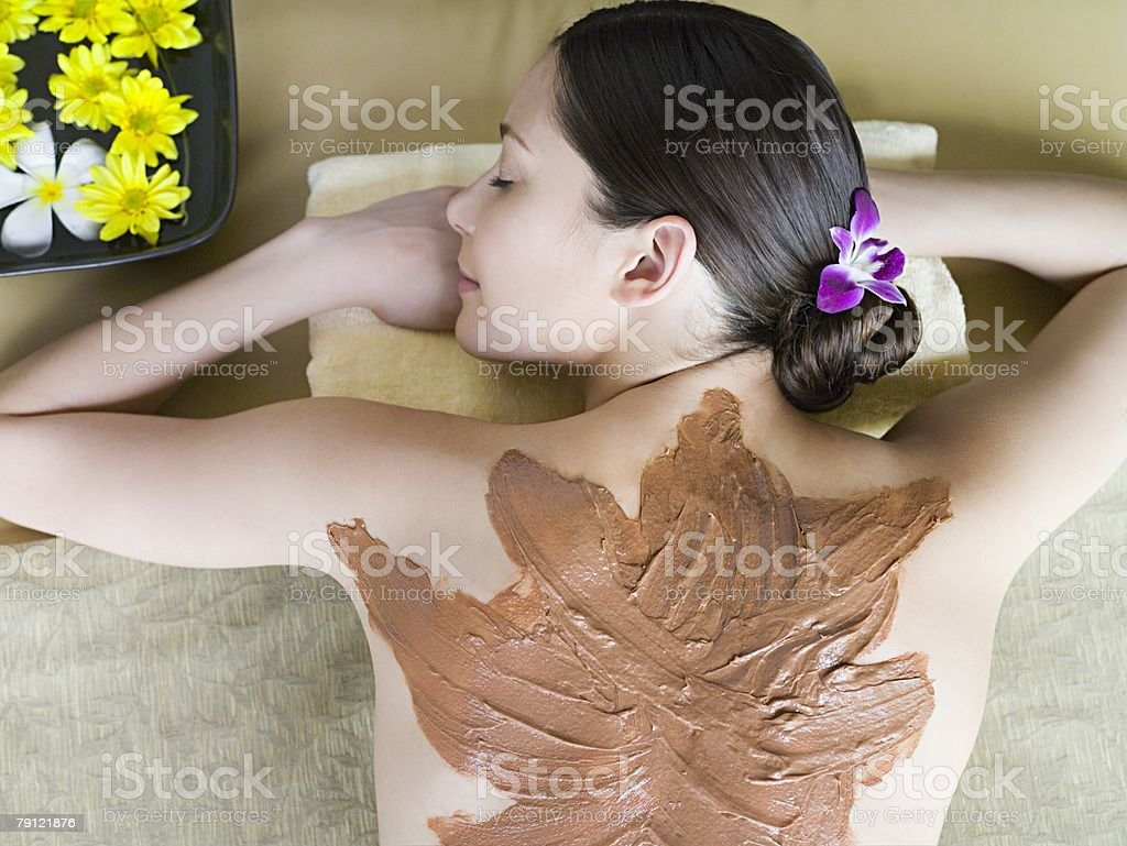 Young woman wearing a body mask stock photo