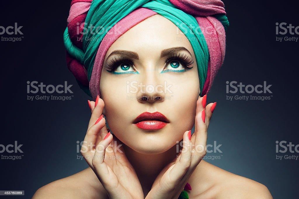 Young woman wearing a colorful turban stock photo