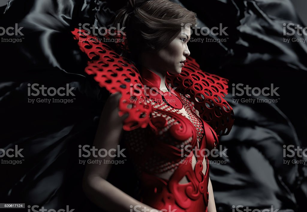 young woman wearing a gothic red dress stock photo
