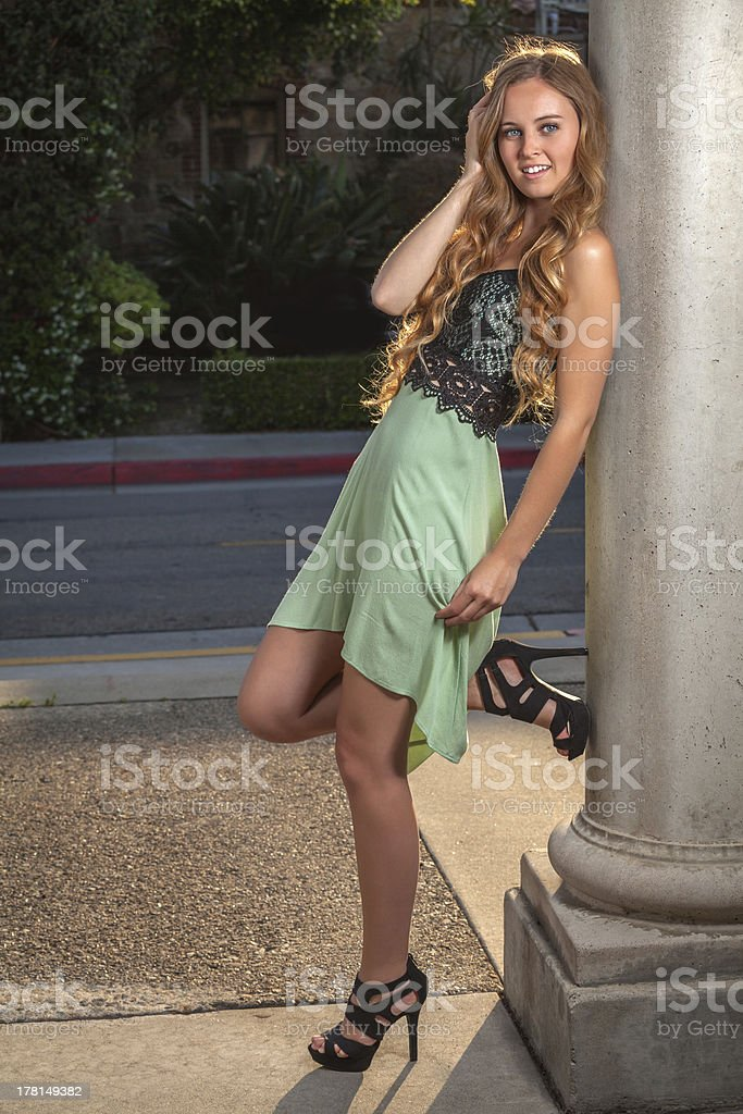 Young woman wearing a green dress royalty-free stock photo