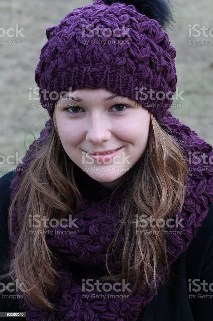 Young woman wearing a knitted winter hat and scarf stock photo