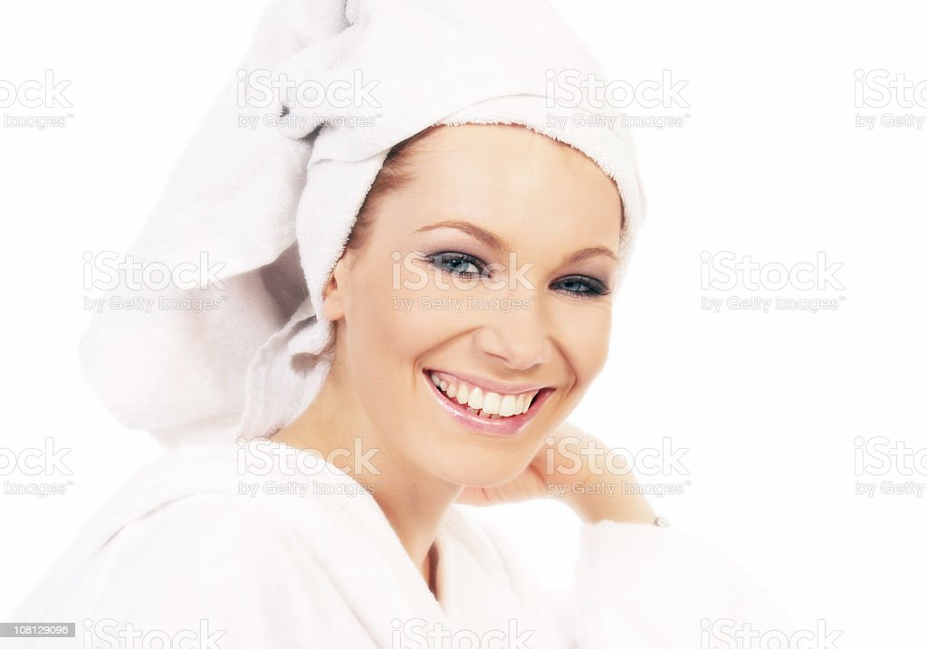 Young Woman Wearing Bathrobe and Towel Around Head royalty-free stock photo