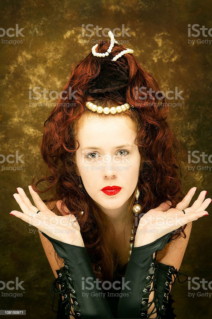 Young Woman Wearing Beaded Crown and Jewellery stock photo