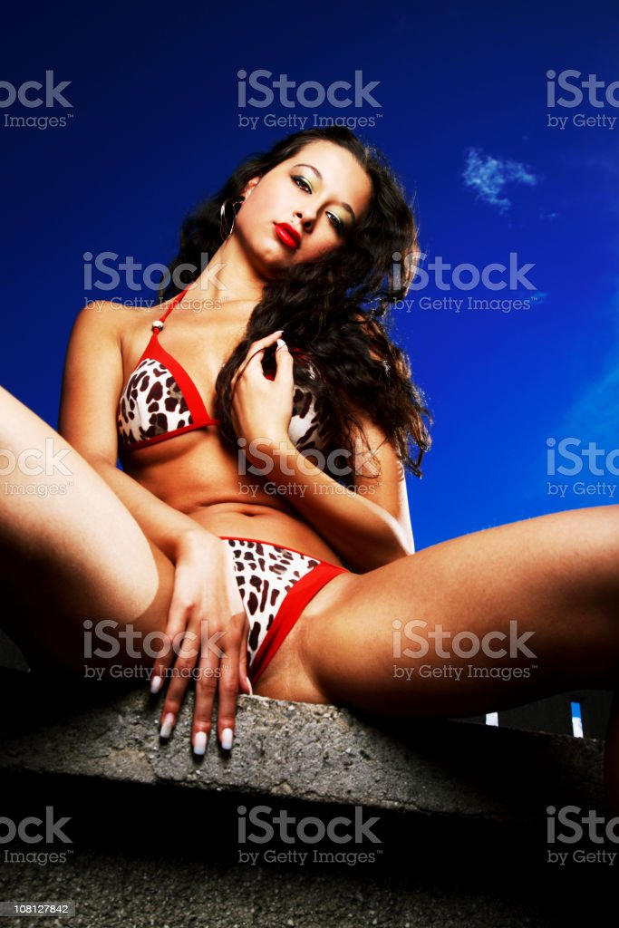 Young Woman Wearing Bikini and Posing Against Blue Sky royalty-free stock photo