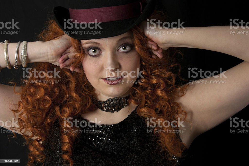 Young woman wearing black sequins and top hat. royalty-free stock photo