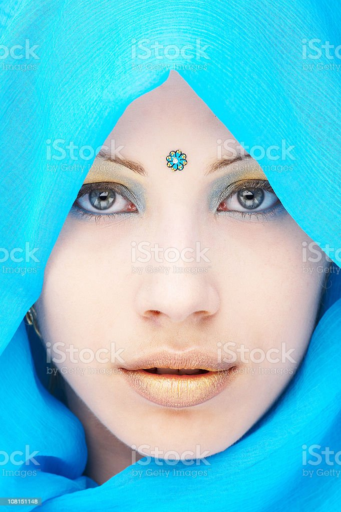 Young Woman Wearing Blue Head Wrap and Dot on Forehead stock photo