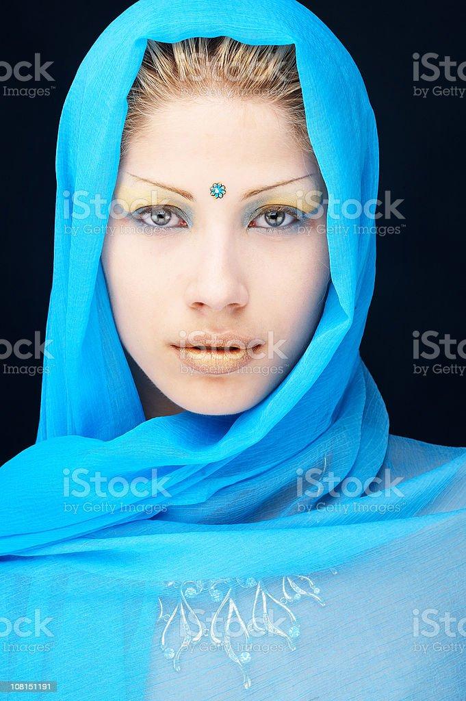 Young Woman Wearing Blue Scarf Around Head with Bindi Dot stock photo