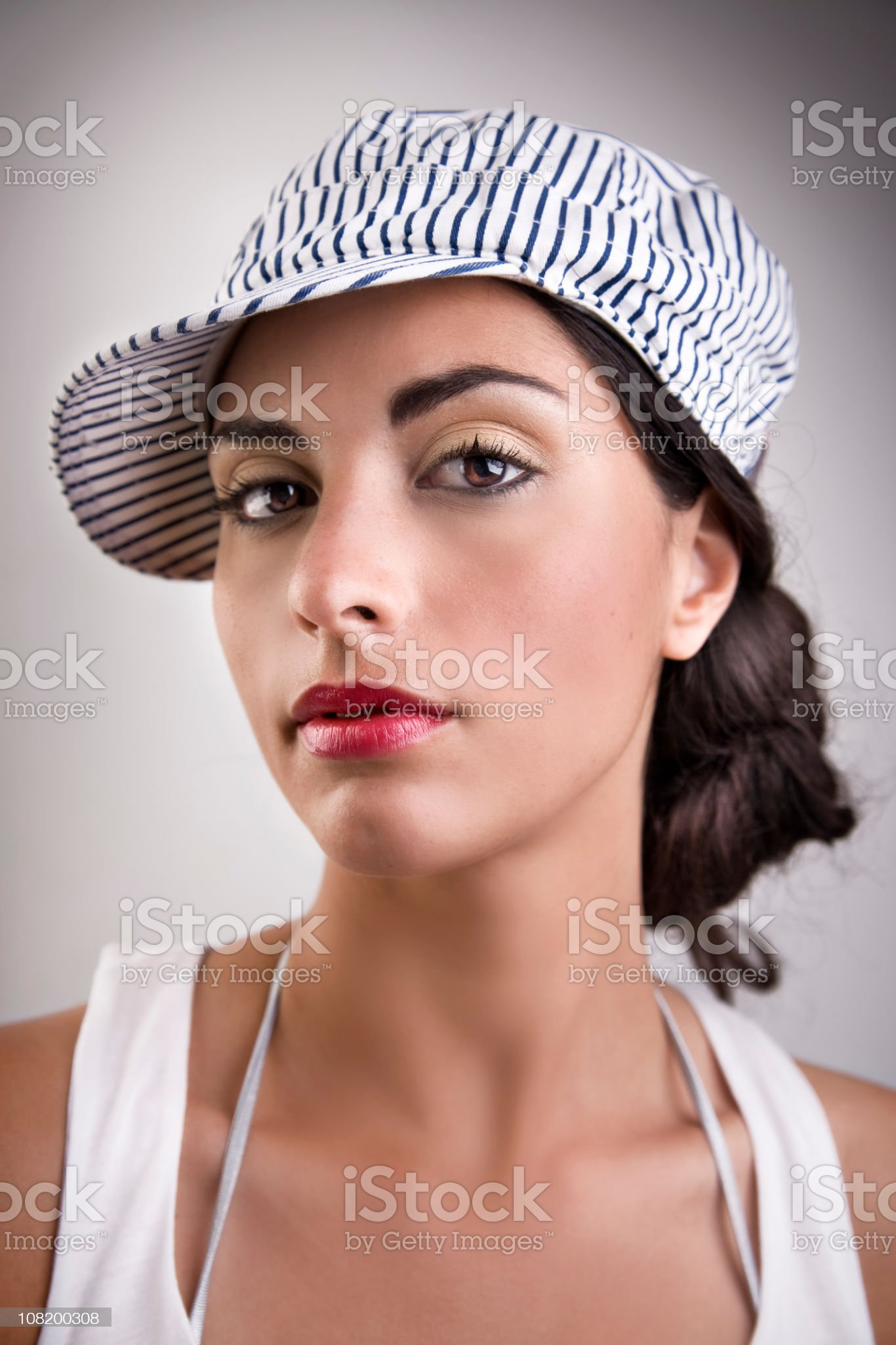 Young Woman Wearing Blue Striped Hat royalty-free stock photo