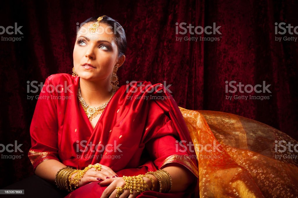 young woman wearing bollywood-style sari stock photo