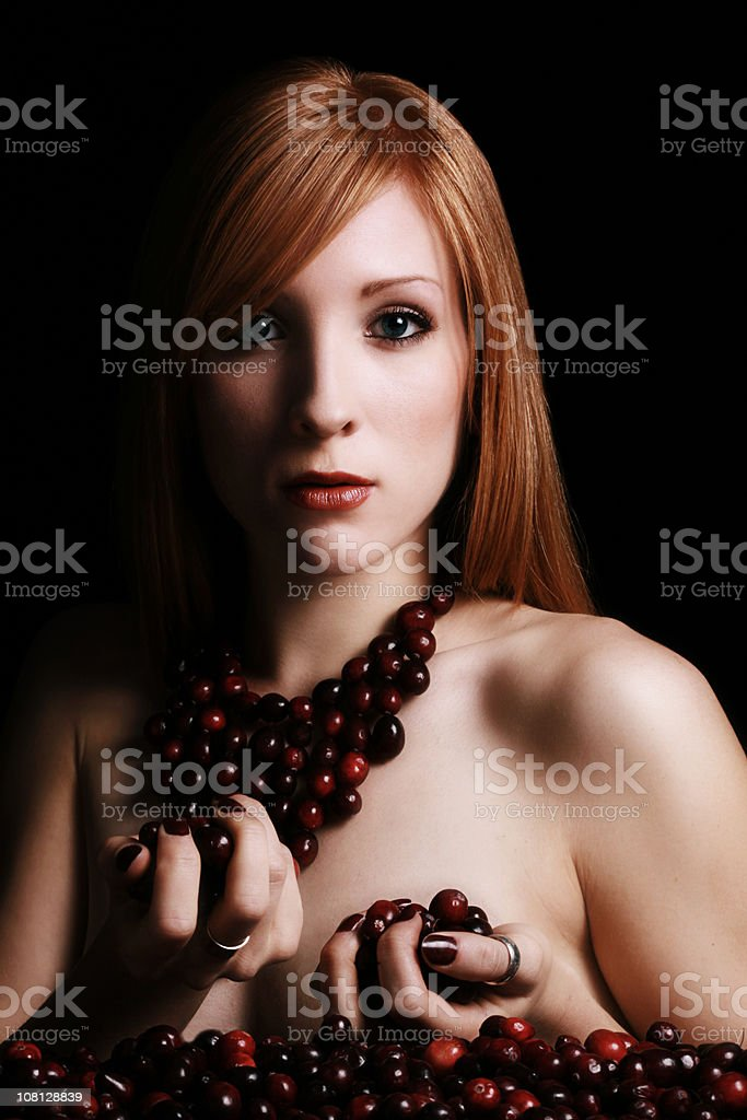 Young Woman Wearing Cranberry Necklace royalty-free stock photo